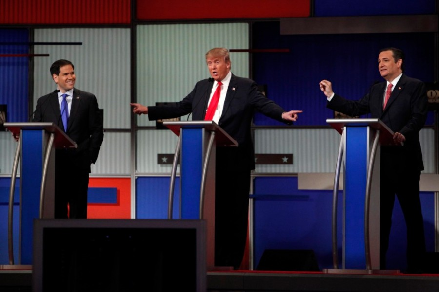 Republican U.S. presidential candidate Trump gestures towards rivals Rubio and Cruz during the Fox Business Network Republican presidential candidates debate in North Charleston